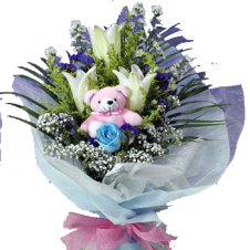 Casa Blanca w/ Babys Breath and Greenery in a Bouquet  and Mini Teddy Bear