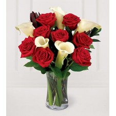 A Nice Presentation of Red Roses with Calla lily in a Vase