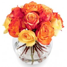 Bright Arrangement of Yellow and Orange Roses in a Globe Vase