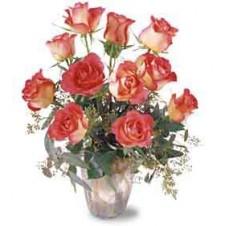 A Dozen Beautiful Roses in a Glass Vase