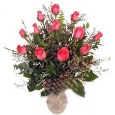 Arrangement of One Dozen Pink Roses in a Glass Vase