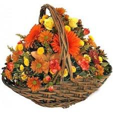 Rounded Seasonal Flower Arrangement in Wicker Basket