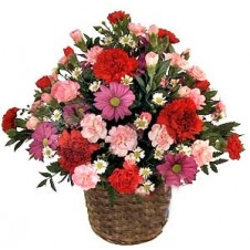 Rounded Mauve, Pink and Red Arrangement in a Wicker Basket
