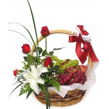 A Basket of Grapes with Flower Arrangement