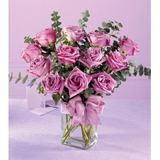 One Dozen Imported Holland Purple Roses* in a Vase
