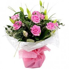 One dozen Pink Roses in a Bouquet