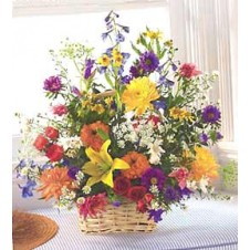 A Basket Of Flowers Contains Many Daisies, Roses, Star Gazer Etc