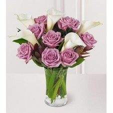 A Nice Presentation of Purple Roses with Calla lily in a Vase
