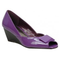 Peep toe wedge with an interesting upper decor by Manels