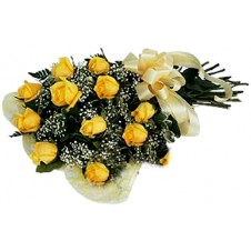 One dozen Yellow Roses With Added Delicate Flowers in a Bouquet