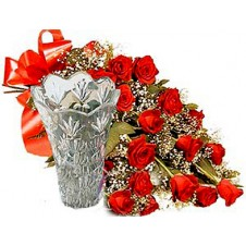 Various Sized Bouquets Of Stunning Red Roses With A Vase