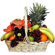 A White Basket Of Full Fresh Fruits
