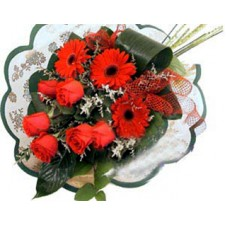 Wrapped Bouquet Of Red Gerbera daises And Roses